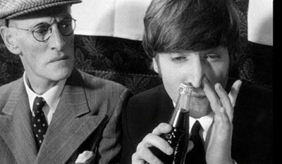 "John Lennon, right, from a scene in the fantastically funny film, ""A Hard Day's Night."" Lennon is ""sniffing a coke"" while sitting next to Wilfrid Brambell who plays Paul McCartney's grandfather, constantly referred to as ""a clean old man"" and the source of great trouble to the Beatles in the show."