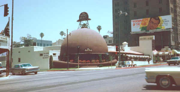 The original Brown Derby at 9537 Wilshire Boulevard. It was a landmark restaurant in Los Angeles, which was frequented by celebrities during the Golden Age of Hollywood. It was an example of novelty architecture, known for being physically shaped like a brown derby hat, for being the birthplace of the Cobb salad (which was named for the Cobbs, the owners of the Derby), and the home of hundreds of caricatures of celebrities.