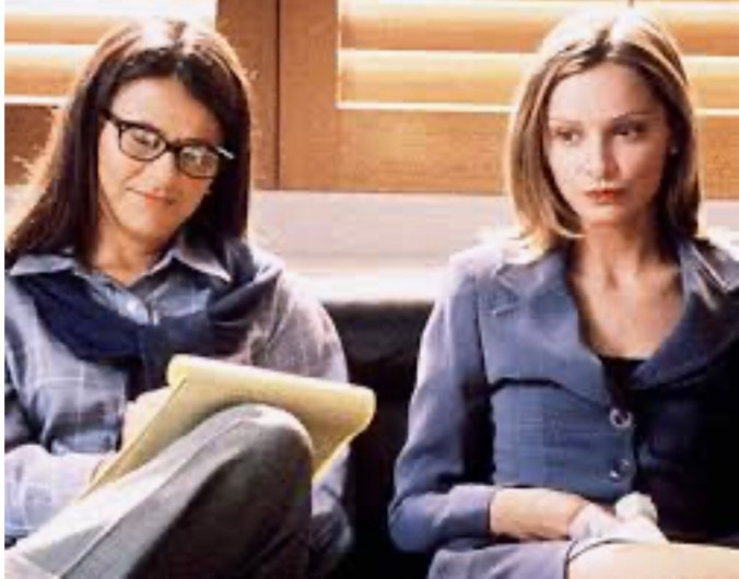 image from TV show Ally McBeal with Calista Flockhard (playing Ally) sitting next to her therapist played by Tracy Ullman