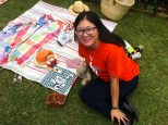 Xuemei - from our team of volunteers - on a beautiful teddy bears picnic rug