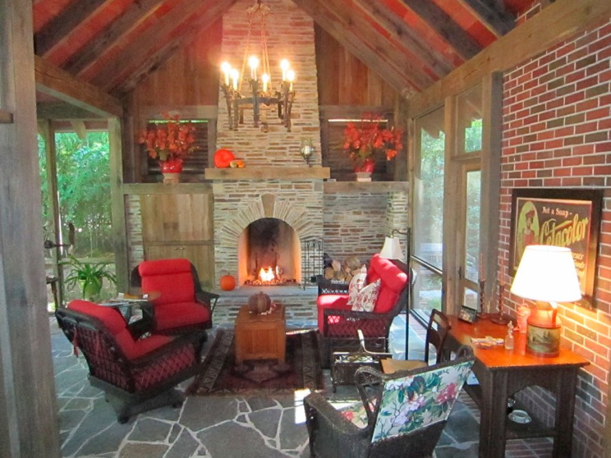 The Fireplace and Red cushons welcome you in—love the Chandelier