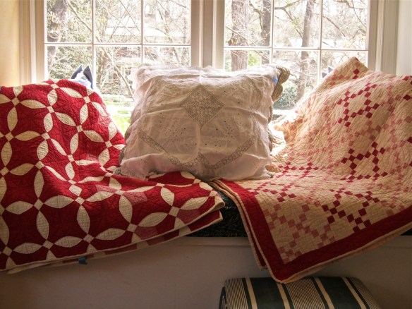 Two antique red and white quilts looking for a good home