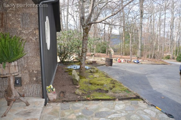 Before the entry was bare and was edged in landscaping timbers—very boring