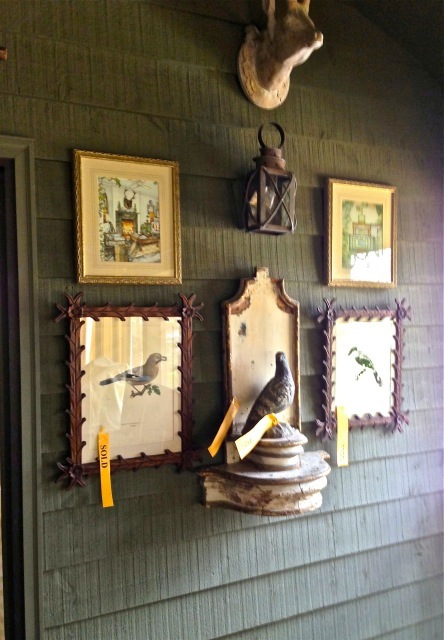 This arrangement is on the screen porch—love the bird prints and frames. The small prints above are of David Easton's house
