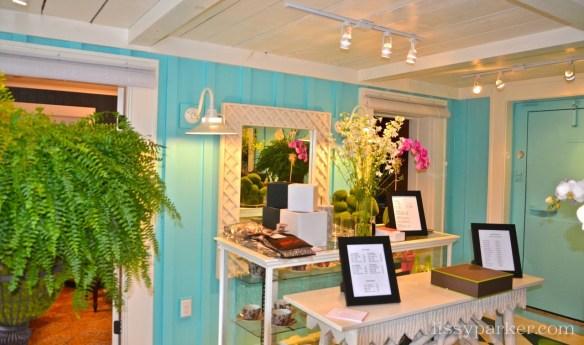 Aqua walls and painted bark tables and mirrors