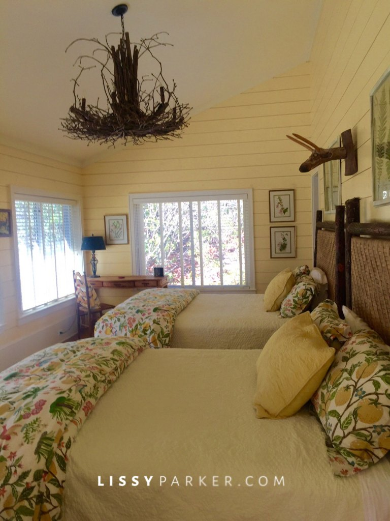 Back up the stairs is a charming guest room