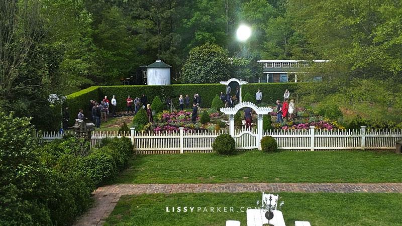 TV crew filming in the boxwood garden