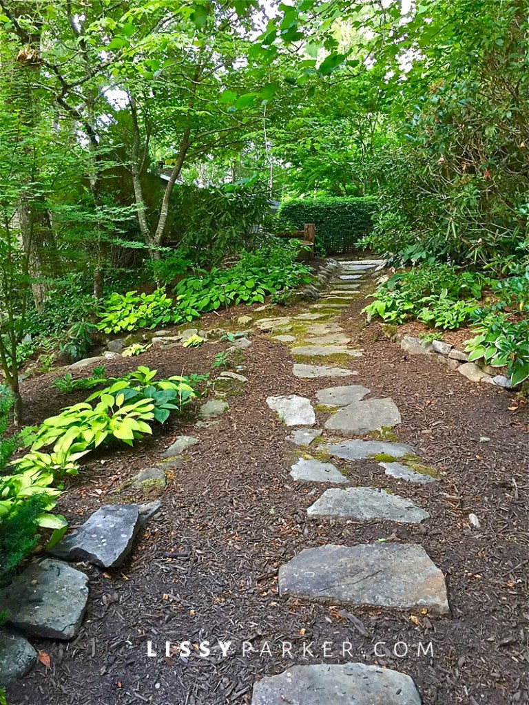 house crush stone path leads to a tranquil garden