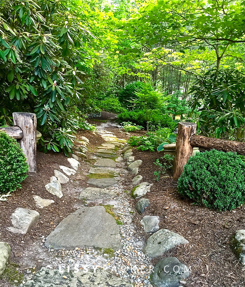 house crush stone and gravel path leading into a garden