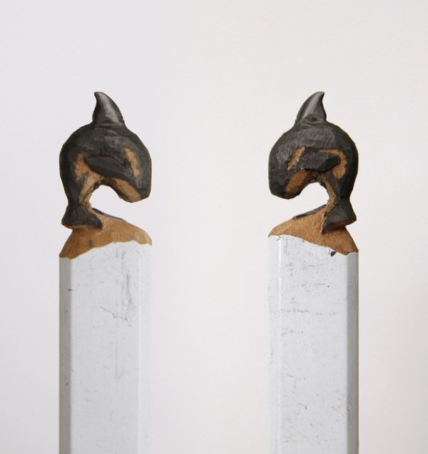 dolphins carved in pencil
