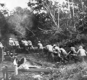 Roosevelt crew carrying heavy boats on a trail around the River of Doubt rapids