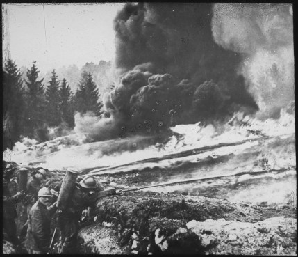 French soldiers making a gas and flame attack on German Trenches in Flanders during World War One.