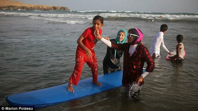 Briton, teaching women surfing on the coast of Iran