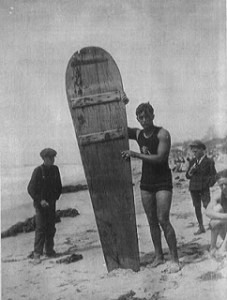 Jack London stands with an original surf board 1907