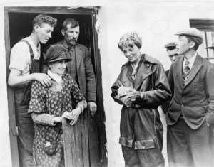 Amelia Earhart and crew are greeted by a farm family who witnessed their landing