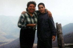 mom and son in front of mountains