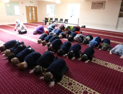 Year 2 children, aged 6 and 7 from Moordown St John's Church of England Primary School are encouraged to bow down in prayer at Gloucester Mosque.