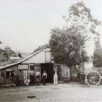 The blacksmith's shop in the main street of Meadows, with the black smith and two other men standing outside.