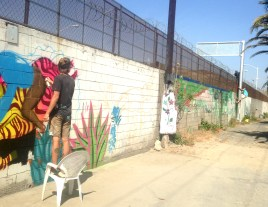 People Hopping Border While Painting Mural