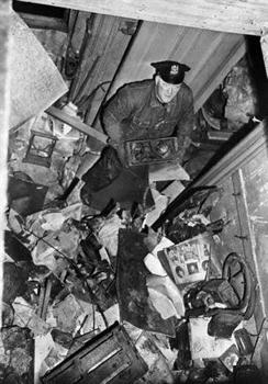 Policeman Searching Through Debris In Mansion (Custom)