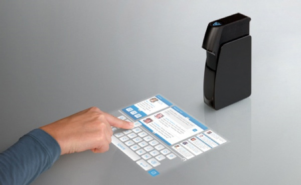 Light-Touch-Projector-Transforms-A-Tabletop-Into-A-Touch-Screen1