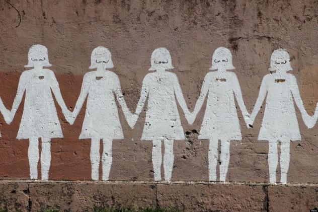 Paper doll graffiti in a public street - Rome