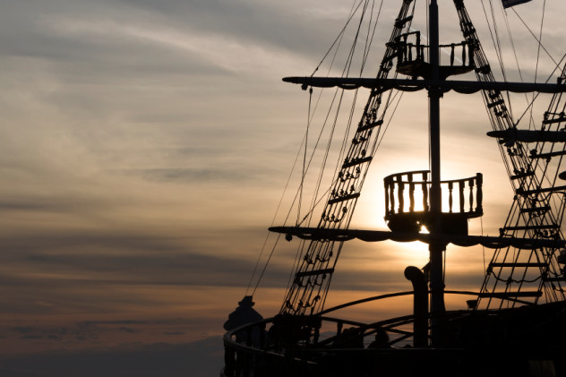 Silhouette of sails of an antique ship, masts and bowsprit of a