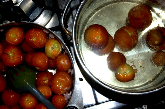 Tomatoes boiling for skinning