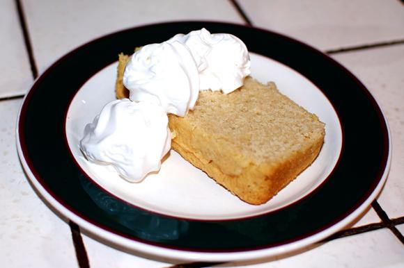 slice of vegan poundcake with soy whipped cream