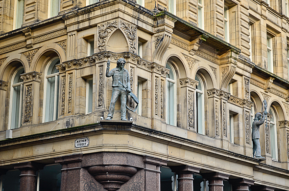 John Lennon statue on building