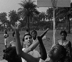 1962, Lagos, Nigeria --- Original caption: Sherman Rosenberg of Chicago, (C), a chemistry teacher at Queens college in Lagos, plays basketball with her students of the college, a secondary school for girls. Rosenberg introduced the sport to the country. The basketball was donated by an American. --- Image by © Bettmann/CORBIS