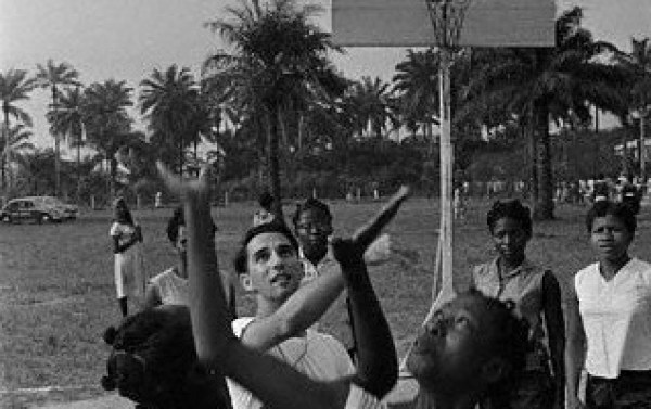 American culture of basketball enters Nigeria through a chemistry teacher at Queens college in Lagos, who here plays basketball with her students of the college, a secondary school for girls. Rosenberg introduced the sport to the country.