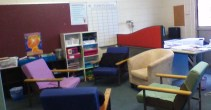 The 'comfy' chairs. We use this area for small group time and rewards. The white shelves behind the chairs hold teacher reference books, math manipulatives, and literacy/ numeracy games.