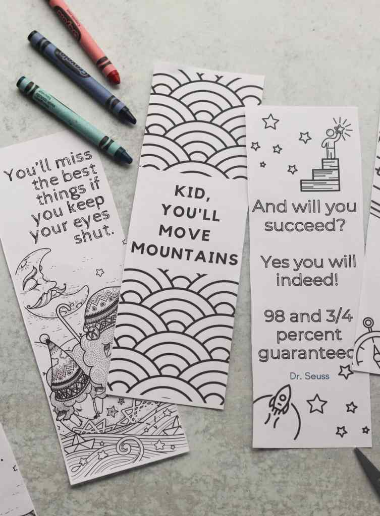 Close up of three of the printed coloring bookmarks with crayons.