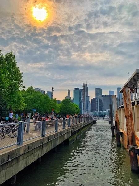 Manhattan skyline as scene from the Brooklyn Bridge Park