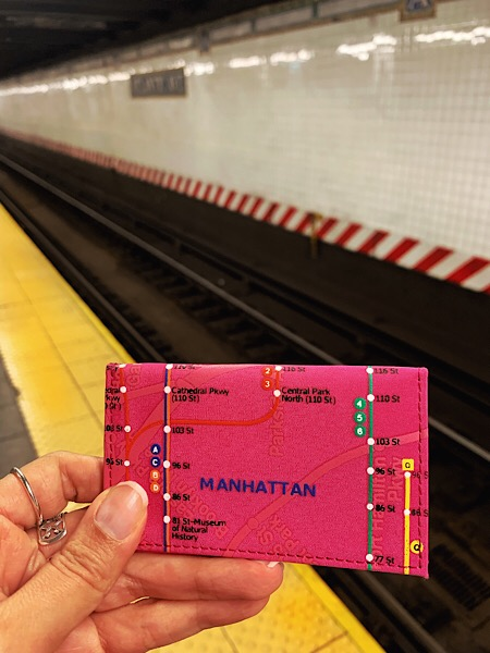 Picture of my metro card holder in front of the subway train tracks