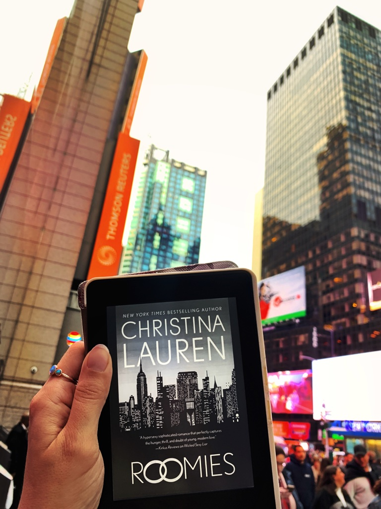 Picture of the book Roomies by Christina Lauren with New York City as the backdrop