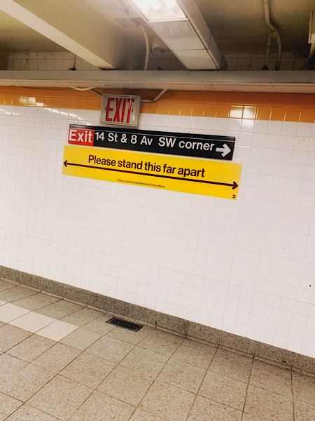 Six feet apart sign in a Manhattan subway station
