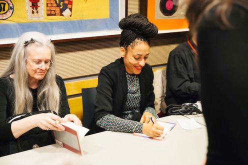 Sharon Olds and Zadie Smith signing books