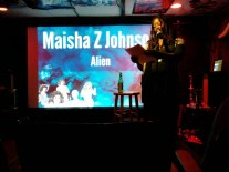 Maisha Z. Johnson. Click to watch Maisha read at Featherboard Writing Series.