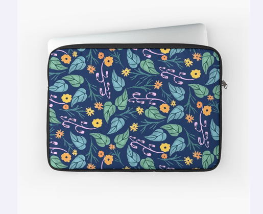 A heart shaped motif with yellow,red and orange flowers and aqua green leaves. Laptop Sleeve