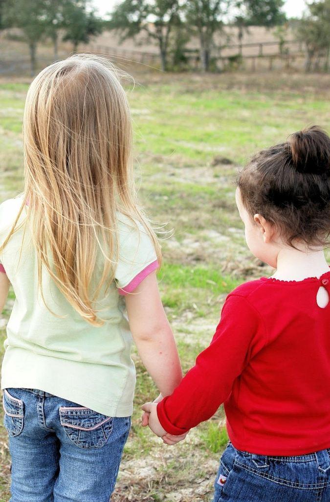 little angels inc girls holding hands