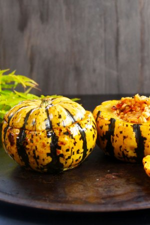 Baked minikin pumpkins stuffed with pearl barley for a healthy meat free meal