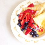 crepes with berries and maple syrup
