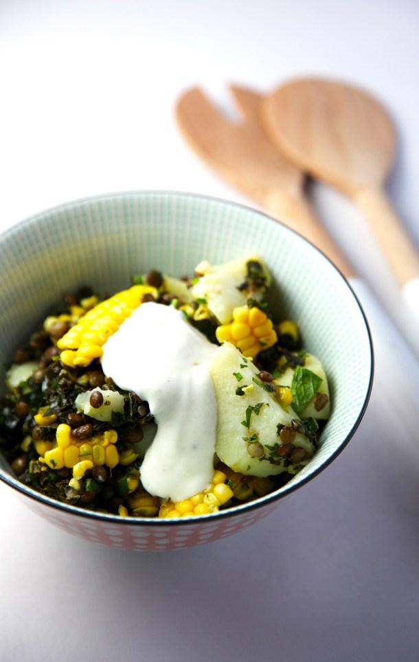 Warm lentil salad with potato, corn and kale