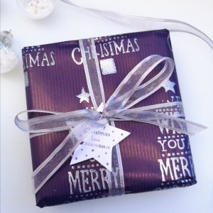 Handprinted Purple Gift wrap with metallic silver Christmas themed images- including Christmas trees and snowflakes