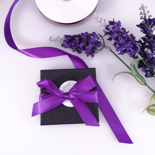 Gift Box Packaging, black branded gift bow, tied with a purple satin ribbon