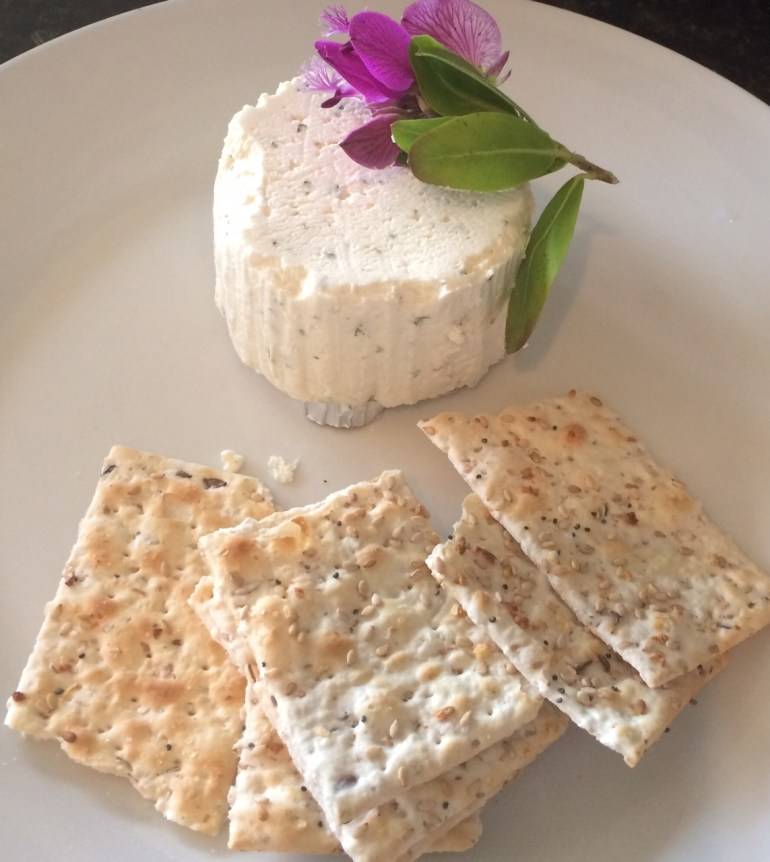 Crackers and Soft Ripe Cheese Appetizer, Purple Flower On Cheese Plate, Happy Hour Treats