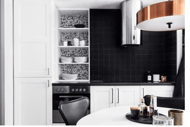 Fantastic Frank's black tile kitchen with copper light fixture and chrome range mixed metals