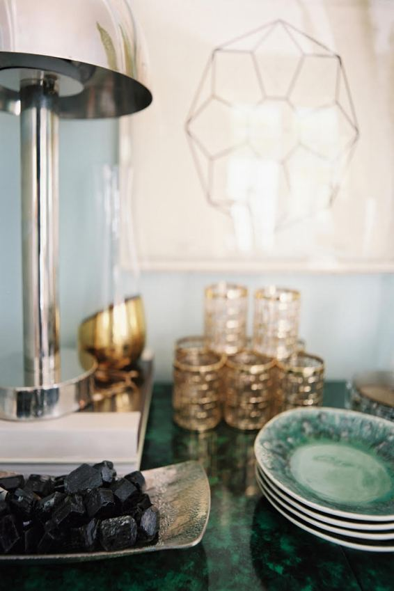 Lonny chrome table lamp with gold highball glasses on buffett